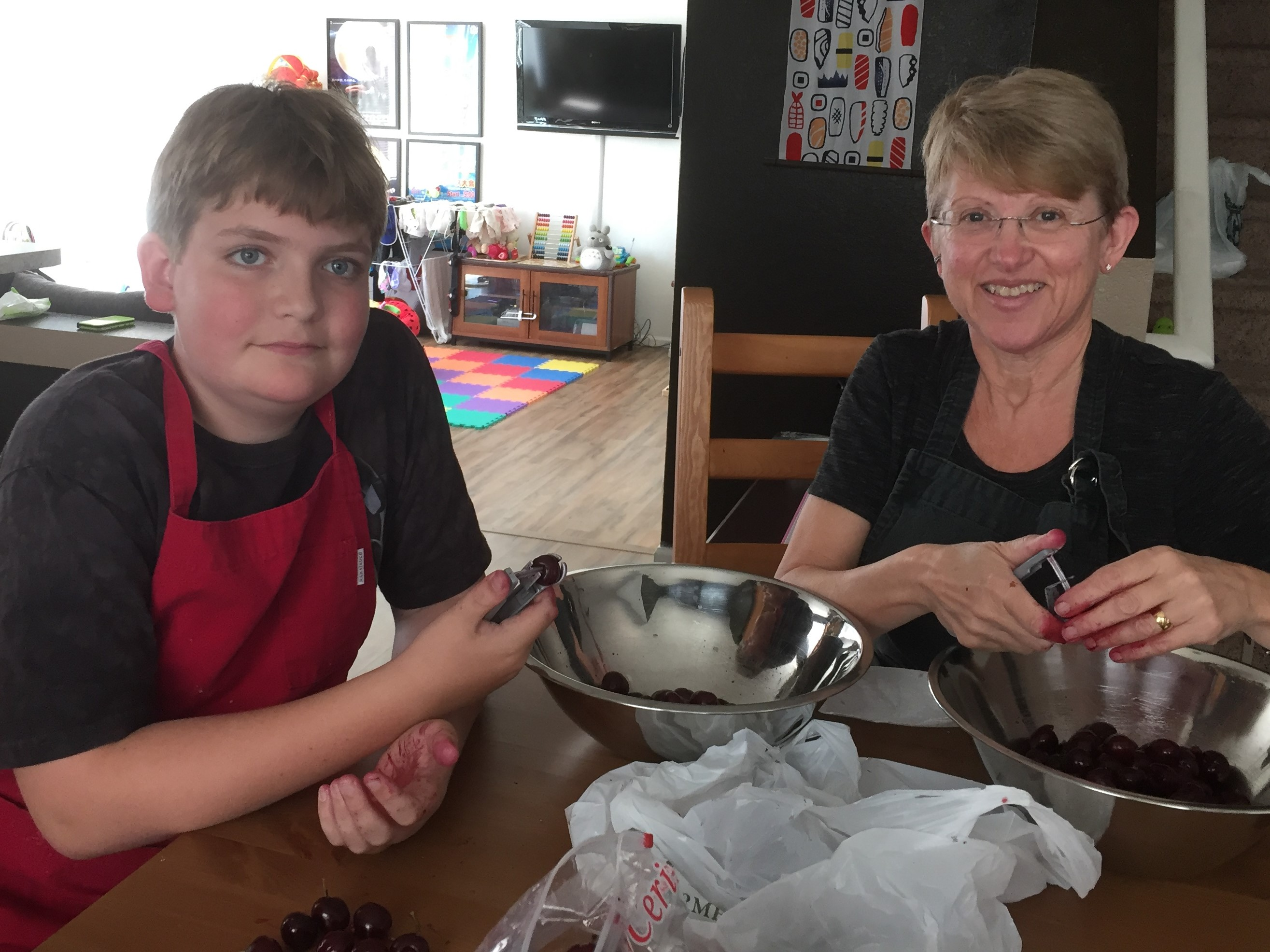 Stephanie and Mile pitting cherries 2017